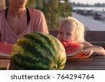 funny kid girl eat watermelon... | Shutterstock . vector #764294764