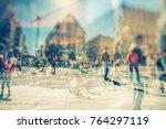 silhouette of people walking on ... | Shutterstock . vector #764297119