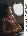 girl near the window in... | Shutterstock . vector #764297401