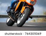 man riding motorcycle in... | Shutterstock . vector #764305069