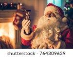 happy santa claus in eyeglasses ... | Shutterstock . vector #764309629