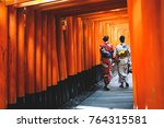 two woman walking through... | Shutterstock . vector #764315581