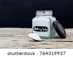 jar and spoonful of baking soda ... | Shutterstock . vector #764319937