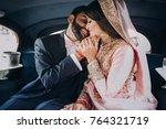 handsome indian groom dressed... | Shutterstock . vector #764321719