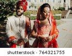 indian groom dressed in white... | Shutterstock . vector #764321755