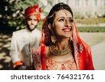 indian groom dressed in white... | Shutterstock . vector #764321761