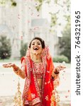 stunning indian bride dressed... | Shutterstock . vector #764321965