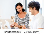 happy modern couple working on... | Shutterstock . vector #764331094
