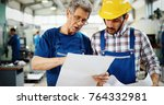 engineer teaching apprentices... | Shutterstock . vector #764332981