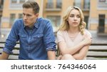 Stock photo girlfriend and boyfriend sitting next to each other angry couple fighting 764346064