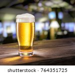 frosty glass of light beer on... | Shutterstock . vector #764351725