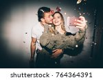 new year's party. girl and boy... | Shutterstock . vector #764364391