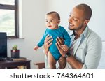 happy black father and his baby ... | Shutterstock . vector #764364601