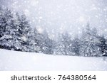 snow covered fir trees in heavy ... | Shutterstock . vector #764380564
