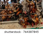 Small photo of KAMPALA, UGANDA – NOVEMBER 10, 2017: Transporting alive chicken on the road to Kampala Uganda. This is very cruel as the chicken are still alive and the truck is driving 80km/h
