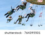 a rotating chair swing ride... | Shutterstock . vector #764395501
