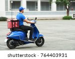 Courier On The Scooter...