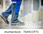 safety boots and trousers of a... | Shutterstock . vector #764411971