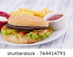 hamburger with chips | Shutterstock . vector #764414791