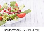 salad with pomegranate close up | Shutterstock . vector #764431741