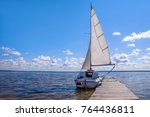 the yacht is near the pier.... | Shutterstock . vector #764436811