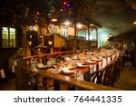 table set for a festive dinner... | Shutterstock . vector #764441335