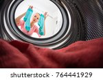 young woman doing laundry  ... | Shutterstock . vector #764441929
