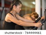beautiful woman at the gym... | Shutterstock . vector #764444461