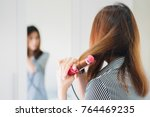 back view of hands drying woman ...   Shutterstock . vector #764469235