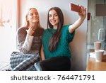 smiling young women taking... | Shutterstock . vector #764471791