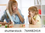 cute child boy at speech... | Shutterstock . vector #764482414