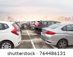 a row of new cars parked at a... | Shutterstock . vector #764486131