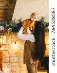 mom and son near christmas... | Shutterstock . vector #764528587