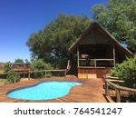 safari lodge with swimming pool   Shutterstock . vector #764541247