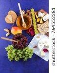 cheese  camembert  wooden board ... | Shutterstock . vector #764552281