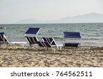sun loungers empty at seaside... | Shutterstock . vector #764562511