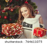 girl with gift boxes near... | Shutterstock . vector #764611075