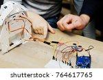 firl making a robot at a stem... | Shutterstock . vector #764617765