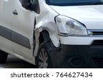 damaged car in collision | Shutterstock . vector #764627434