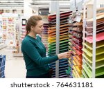 woman buys colored paper at the ... | Shutterstock . vector #764631181