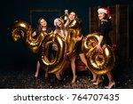 girls in red santa hats having... | Shutterstock . vector #764707435