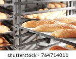 loaves of bread on shelving in... | Shutterstock . vector #764714011