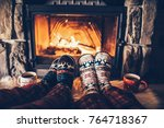 feet in woollen socks by the... | Shutterstock . vector #764718367