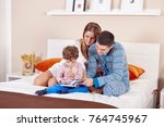 young happy family is staying... | Shutterstock . vector #764745967