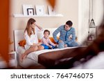 young happy family is staying... | Shutterstock . vector #764746075