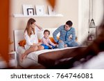 young happy family is staying... | Shutterstock . vector #764746081