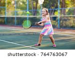 child playing tennis on outdoor ...   Shutterstock . vector #764763067