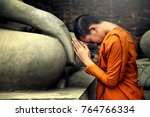 asia novice monk worship the... | Shutterstock . vector #764766334