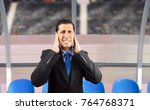 portrait of coach covering his... | Shutterstock . vector #764768371