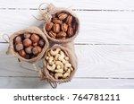 mix of nuts . hazelnut   pecan... | Shutterstock . vector #764781211